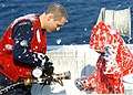 US Navy 060329-N-0490C-005 Damage Controlman Fireman Kyle M. Woehler and Damage Controlman 3rd Class Christine M. Haselton assigned to the Nimitz-class aircraft carrier USS Dwight D. Eisenhower (CVN 69) collect samples of Aqueo.jpg