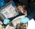 US Navy 070321-N-9758L-061 Machinist's Mate Fireman Zahir N. Khan puts fuel samples in the centrifuge testing for bottom sediments and water while Essex takes on fuel at Akasaki Fueling Station in preparation for the 46th Exerc.jpg