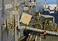 US Navy 070607-N-3211R-039 Sailors aboard amphibious assault ship USS Bonhomme Richard (LHD 6) load stores and equipment into the ship's upper vehicle storage through the starboard side port.jpg