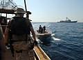 US Navy 070926-N-0841E-118 Boarding team members from the guided-missile frigate USS Carr (FFG 52) render assistance to a United Arab Emirates-flagged fishing dhow as part of an interaction patrol.jpg