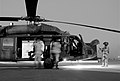 US Navy 071117-N-9643K-001 The crew of a Blackhawk helicopter perform their pre-flight checks before a mission delivering passengers to various locations in northern Iraq.jpg