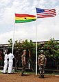 US Navy 071120-N-8933S-082 Ghanaian sailors and U.S. Seabees raise their country's colors at the Africa Partnership Station (APS) ground-breaking ceremony for the construction of a new medical clinic, which will be used by the.jpg