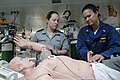 US Navy 080715-N-6270R-082 Lt. Cmdr. Rhonda Bennett and Australian Navy Seaman Kirrilee Blackburne examine and diagnose a simulated patient.jpg