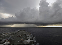 US Navy 080724-N-7241L-002 The aircraft carrier USS Theodore Roosevelt (CVN 71) prepares for flight operations under stormy skies