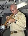 US Navy 080906-N-4680O-115 Chaplain Lt. Thomas Cook plays the trumpet during a.jpg