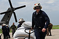 US Navy 080908-N-9774H-204 Sailors stationed aboard the amphibious ship USS Kearsarge (LHD 3), offload food from a CH-53E Super Stallion to provide disaster relief support to citizens of Haiti.jpg