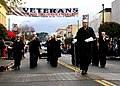 US Navy 081108-N-2296G-030 Sailors assigned to Navy Band Northwest Marching Band Unit play Anchors Aweigh in Auburn's Veterans Day Parade.jpg
