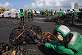 US Navy 081108-N-3659B-236 Storekeeper 3rd Class Rochelle Russell, right, and Storekeeper Seaman Brian Becker tie cargo nets in a bundle at the completion of a vertical replenishment.jpg