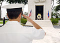 US Navy 090812-N-7282P-045 Rear Adm. Kevin Donegan, commander of Battle Force 7th Fleet, renders a salute during a wreath laying ceremony at the Manila American Cemetery and Memorial.jpg