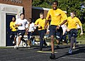 US Navy 091003-N-5366K-068 Navy Junior ROTC members begin a 1.5-mile run during a Navy SEAL Fitness Challenge held at Grimsley High School. Naval Special Warfare (NSW) operators hosted the event.jpg