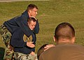 US Navy 091112-N-8816D-245 Builder 3rd Class Ryan Sparks allows Utilitiesman 3rd Class Jonathan Cox to demonstrate the proper technique for applying a choke during martial arts training.jpg