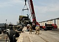 US Navy 100309-N-6676S-109 Sailors assigned to Landing Craft Unit (LCU) 1660 watch as a truck is craned onto the pier in Tema, Ghana.jpg