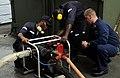 US Navy 100324-N-7948C-430 Damage Controlman 2nd Class Gary Darling discusses the proper operation of a P-100 pump with Nigerian navy Seaman Quarter Armory 3rd Class Henry Dairo.jpg