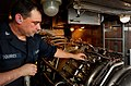 US Navy 110204-N-9589S-195 Gas Turbine System Technician (Electrical) 3rd Class Christopher A. Squires verifies a repair on a gas turbine engine.jpg