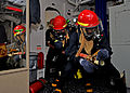 US Navy 110930-N-ZF681-490 ailors simulate fighting a fire during a general quarters drill aboard the guided-missile destroyer USS Halsey (DDG 97).jpg