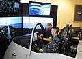 US Navy 111109-N-FC065-001 A contractor explains the differences between displays in a Navy F-35 demonstrator.jpg