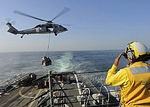 US Navy 111213-N-VH839-020 A Sailor signals a helicopter.jpg