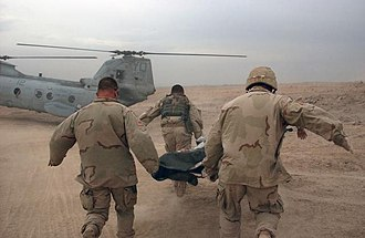 Second Battle of Fallujah - U.S. Army soldiers rush a wounded soldier to a waiting U.S. Marine CH-46E Sea Knight helicopter during the Second Battle of Fallujah in November 2004.