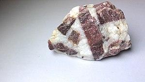 Baraboo Quartzite - A Baraboo Quartzite sample, in breccia form. The brecciated purple portions are quartzite, and the matrix is white quartz