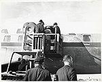 Unidentified men and woman boarding plane (10425771314).jpg