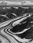 Unknown glacier, valley glacier with prominant moraines, date unknown (GLACIERS 5129).jpg