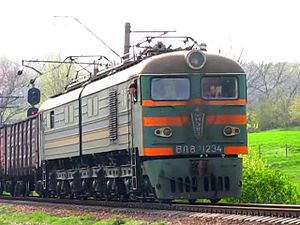 Файл:VL8m-1234 with freight train.webm