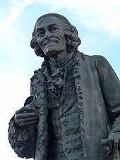 Statue von Voltaire in Ferney, 1890, Bildhauer: Émile-Placide Lambert (1828–1897) (Quelle: Wikimedia)
