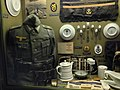WW2 German uniform of the Navy uniform tunic, side cap, badges, items etc. La Valletta Military Museum on Guernsey.jpg