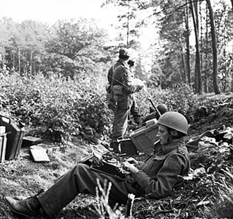 Typing - War correspondent typing his dispatch in a wood outside Arnhem, 1944