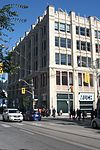 Wesley Building, 299 Queen Street West, Toronto, ON, Exterior, Sept 2013.jpg