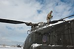 Wings of Destiny clean up after snow storm 130112-A-IA071-094.jpg