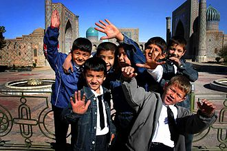 Demographics of Uzbekistan - Boys pose for a picture at Registan. Over a quarter of Uzbekistan's population is under 14 years old.