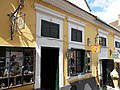 Zweiber yard. Listed (former dwelling) house ID 7373. Baroque, 18th c. 1st half. Stone framed windows with rosette. Gallery, shops, signboards. - 4, Görög St., Szentendre, Pest county, Hungary.JPG