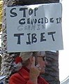 """STOP GENOCIDE IN COMMIE TIBET"" sign detail, 2008 Olympic Torch Relay in SF - Embarcadero 02 (cropped).JPG"