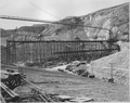 """""""View from the lower end of west cofferdam showing Westmix plant and placing trestles. In the foreground appears a... - NARA - 294305.tif"""