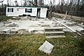 (Hurricane Katrina) Waveland, MS, January 28, 2006 -- This destroyed house and debris is a result of Hurricane Katrina's landfall at this small Mississippi coastal town. The effects - DPLA - 59102302eb7088feeb129c571fcaabd3.jpg