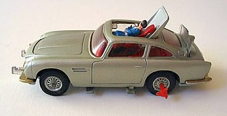 Goldfinger (film) -  alt=a silver-coloured toy car showing a plastic man being ejected through the roof.