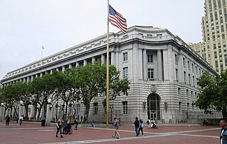 Photograph of the Federal Office Building, an imposing, five-story, stone building in an urban setting