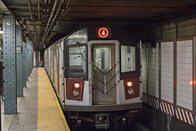 4 train leaving Harlem on August night.jpg