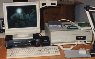 Desktop video - An Amiga 2000 desktop video system. The CPU unit is to the right with the monitor sitting on a VCR.