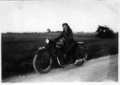 AJS motorcycle with rider.png