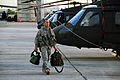 A U.S. Army UH-60 Black Hawk helicopter crew member assigned to the Puerto Rico Army National Guard prepares to conduct night flight training at the aviation support facility in Isla Grande, Puerto Rico, Sept 140902-Z-KD550-558.jpg