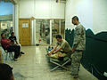A U.S. Soldier demonstrates how to apply a field dressing to Iraqi policemen during Army Skill Level 1 first aid training at Joint Security Station Justice, Iraq, Aug 110808-A-NW580-072.jpg