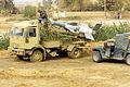 A US Marine Corps (USMC) member checks the warhead on a truck-mounted Iraqi S-125 SAM.JPEG