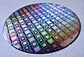 A Wafer of the Latest D-Wave Quantum Computers (39188583425).jpg