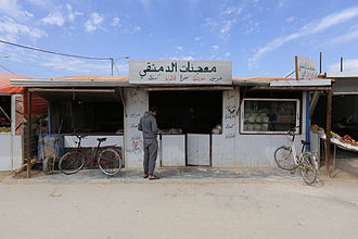 Zaatari refugee camp - A bakery shop made by the residents of Al-Za'tari camp for Syrian refugees in Jordan. Many Syrian refugees have started their businesses in the camp for living, which created a popular market in the camp. (By/ Mustafa Bader)