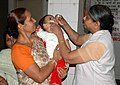 A child being administered Polio Vaccine at a Pulse Polio Immunization camp, in New Delhi on May 24, 2009 (1).jpg