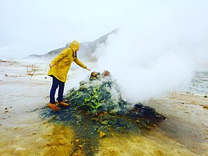 Krafla - A girl is standing near the steaming Krafla volcanic area at Hverir