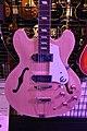 A light pink violin style guitar from Hong Kong.jpg