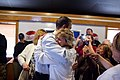 A patron hugs President Barack Obama during a lunch stop at Duff's Famous Wings in Cheektowaga, N.Y., May 13, 2010.jpg